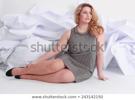 Mooie plus size gekruld jonge blond vrouw Stockfoto © dashapetrenko