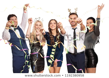 friends at christmas party throwing serpentine Stock photo © dolgachov