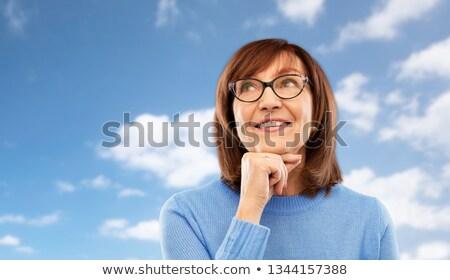 Stockfoto: Portret · peinzend · senior · vrouw · blauwe · hemel · ouderdom
