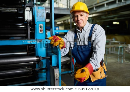 Senior man operating machine units in modern factory standing by Stock photo © boggy