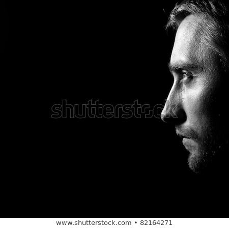 Profile low key portrait of attractive man. Stock photo © lichtmeister