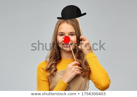 smiling teenage girl with bowler hat party prop Stock photo © dolgachov