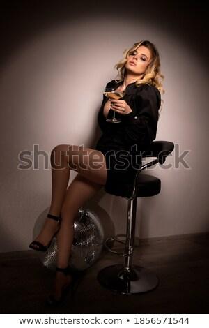 Mooie jonge vrouw fluit champagne disco ball Stockfoto © pressmaster