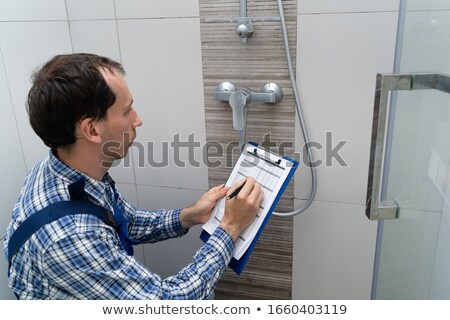 Plumber Checking Faucet In Shower Stock photo © AndreyPopov