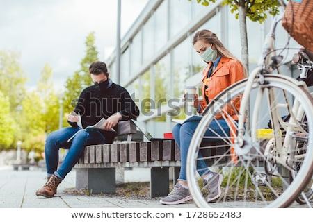 Two college students learning while keeping social distance Stock photo © Kzenon