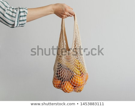 Banana in a reusable bag in the hands of a young woman. Zero waste concept, plastic free concept. He Stock photo © galitskaya