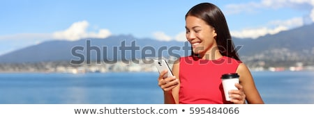 Happy asian woman using phone app in vancouver city harbour on summer day. Beautiful landscape of ca Stock photo © Maridav