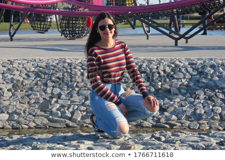 young woman wearing jeans crouching  Stock photo © Rob_Stark