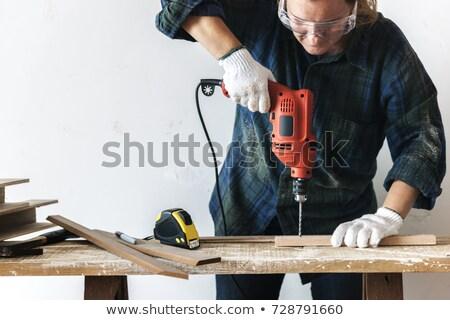 kadın · tornavida · inşaat · duvar · çalışmak · mavi - stok fotoğraf © photography33