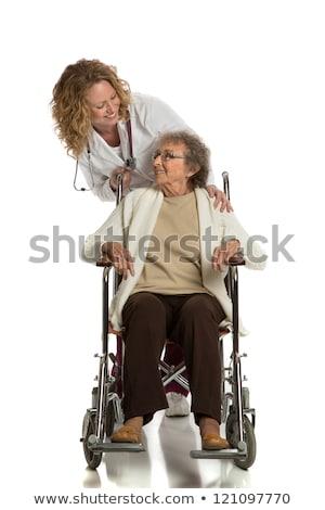Enfermeira empurrando mulher cadeira de rodas espaço Foto stock © photography33