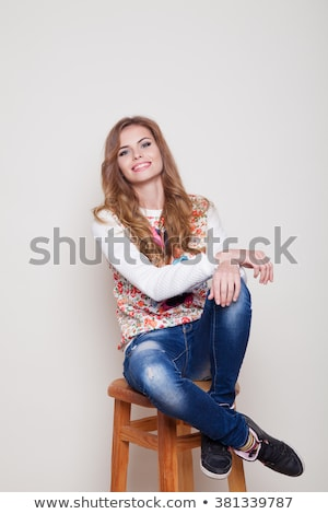 Happy woman in stool Stock photo © curaphotography