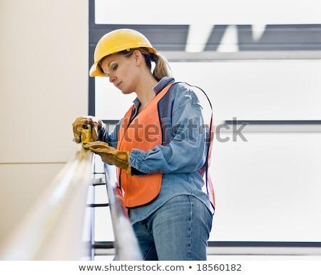 Tolakodó női építőmunkás üzlet boldog építkezés Stock fotó © photography33