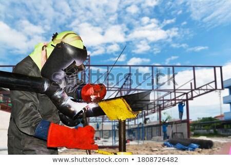 Photo stock: Travailleur · bleu · costume · soudage · métal · lumière