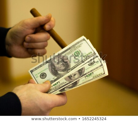 Foto stock: Businessman With A Cigar And A Fistful Of Dollars
