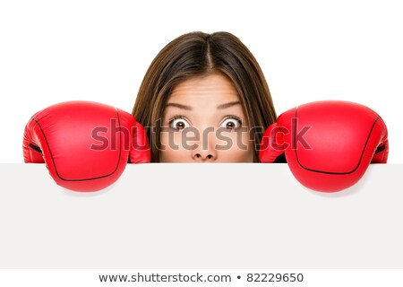Businesswoman holding boxing gloves Stock photo © photography33