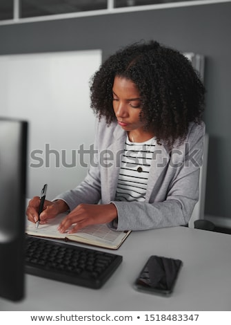 Woman writing in her agenda Stock photo © photography33