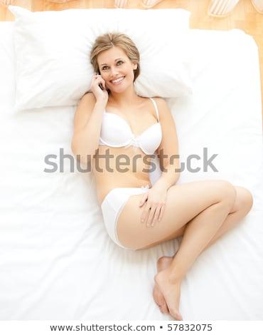 Vidám nő beszél telefon ágy otthon Stock fotó © wavebreak_media