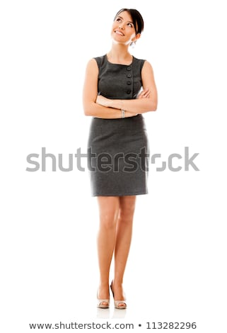Young girl in elegant dress looking up thinking stock photo © jarenwicklund