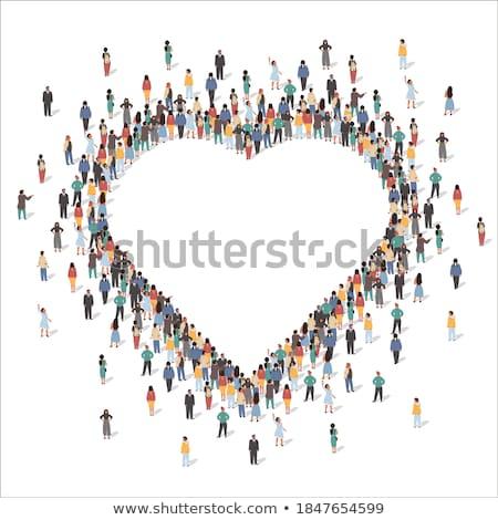 woman forming heart shape stock photo © dolgachov