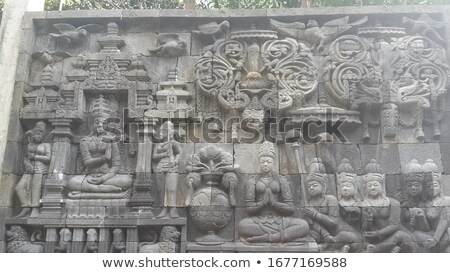 Buddhist carved relief at medieval Borobudur temple on Java, Ind Stock photo © pzaxe