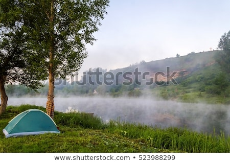 Stock photo: camping tent field over green grass
