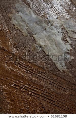 Buz çamur kırmızı kil toprak yol Stok fotoğraf © lunamarina