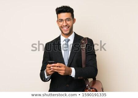 Affaires cellulaires jeunes isolé blanche mode Photo stock © Kurhan