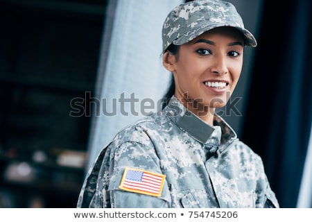 Attractive female American Patriot with flag Stock photo © jeffbanke