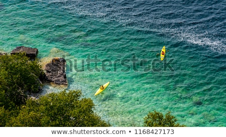 Boat in a bay, Georgian Bay, Tobermory, Ontario, Canada Stock photo © bmonteny