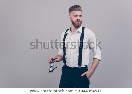 Jovem homem suspensórios isolado preto Foto stock © alexandrenunes