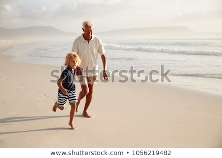 Happy grandson runs with grandfather Stock photo © d13