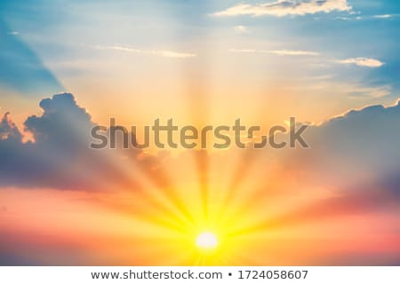 Clouds and sunrays at sunrise Stock photo © Juhku