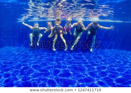 Joven gafas de protección piscina mariposa deportes éxito Foto stock © Paha_L