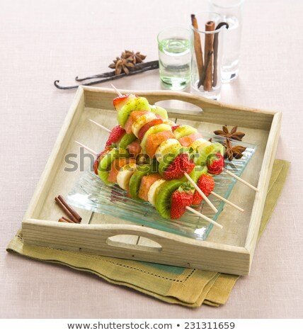 Colorful healthy fruit kebabs on a tray Stock photo © ozgur