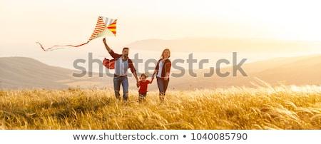 family with kite at sunset Stock photo © adrenalina