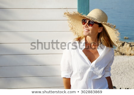 Woman in Hat and Sunglasses Laughing Outdoors Stock photo © ozgur