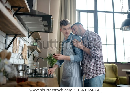 close up of happy male gay couple hugging at home Stock photo © dolgachov