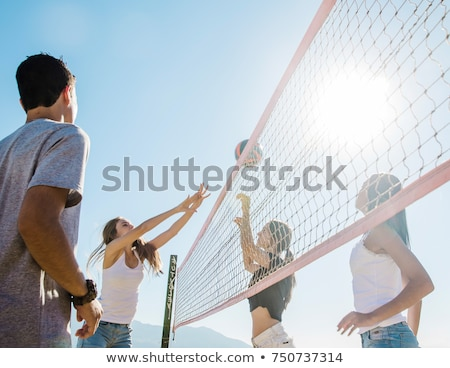 young woman with ball playing volleyball on beach Stock photo © dolgachov