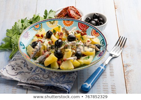 Spiced Tomato Potato Salad with fork Stock photo © janssenkruseproducti