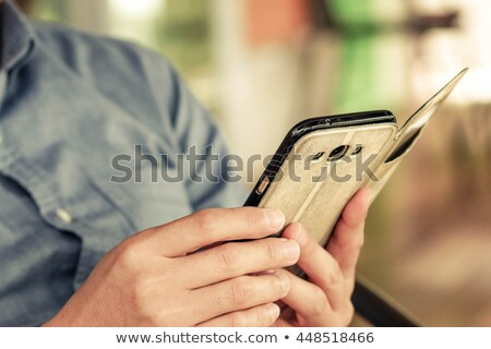 using smartphone case Stock photo © shevtsovy