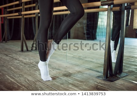 Attractive young dancer warming up at the bar Stock photo © dash