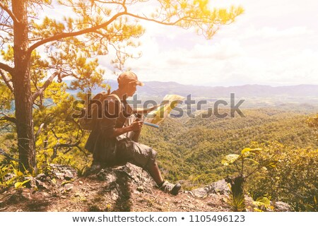 the hiker with a map in misty mountains stock photo © razvanphotography