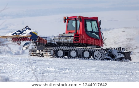 Red snow groomer in the mountain Stock photo © dawesign