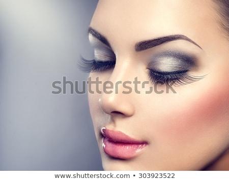 Gyönyörű lány sötét smink gyönyörű fiatal nő szem smink Stock fotó © svetography