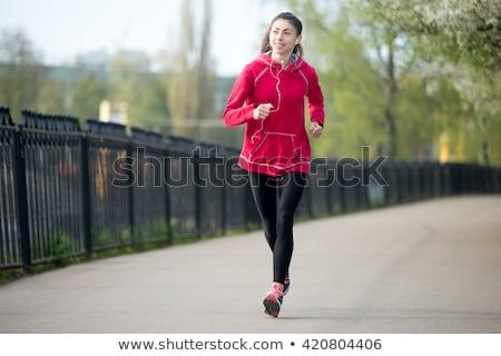 Feliz mujer caliente ropa escuchar música Foto stock © deandrobot