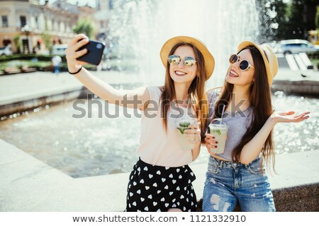 Cheerful woman talking on mobile phone on summer resort Stock photo © deandrobot