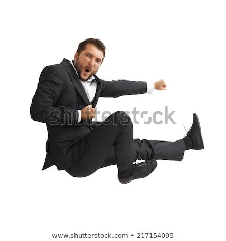 businessman Flying Kick  on white background Stock photo © Istanbul2009