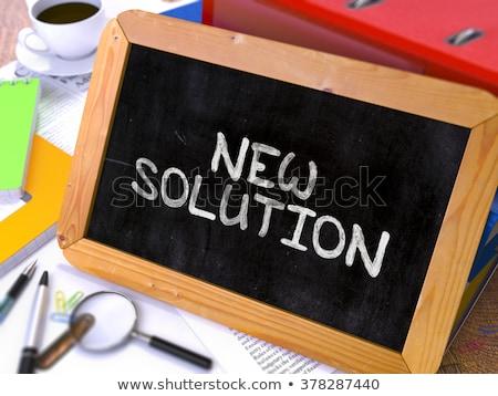 fresh solution   chalkboard with hand drawn text stock photo © tashatuvango