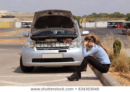 jonge · vrouwelijke · bestuurder · motor · gebroken - stockfoto © aikon