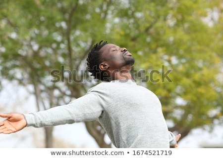 serious african american man outside stock photo © qingwa